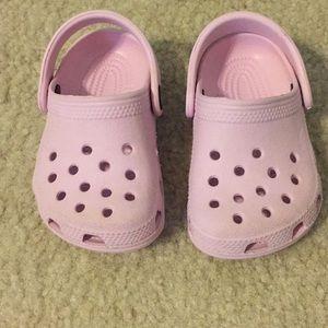 Light pink baby crocs